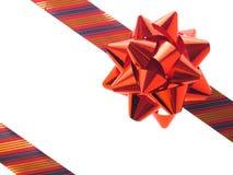 Rotes Geschenkfarbband und -bogen Lizenzfreie Stockbilder