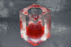 Rotes Getränk am Eisstab Stockfotografie