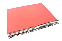 Rotes gewundenes Notizbuch Stockfotografie