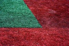 Rotes und grünes Gras lizenzfreies stockfoto