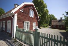 Rotes hölzernes Haus Stockbild