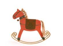 Rotes hölzernes Rockin Pferd Lizenzfreie Stockfotos