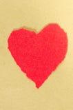 Rotes Herz auf paperbackground Stockbilder