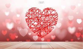 Rotes Herz, das auf hölzernen Beschaffenheitshintergrund mit dem Licht verwischt schwimmt Stockbild