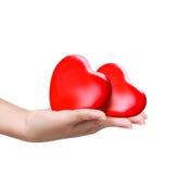 Rotes Herz an der Frauenhand Lizenzfreie Stockbilder
