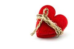 Rotes Herz mit einem Bündel, Konzept mit Liebe mit Knechtschaft stockfotografie