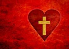 Rotes Herz mit einem Kreuz stockfotos