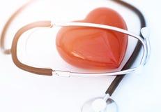 Rotes Inneres und ein Stethoskop Stockfotografie