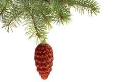 Rotes Kegelspielzeug auf Weihnachtsbaum Stockbild