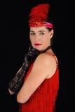 rotes Kleid der schönen Art-Kleidung des Brunette im Jahre 1920 und ein F.E. Stockbild