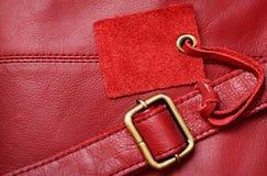Rotes Leder und ein Aufkleber Lizenzfreies Stockbild