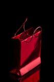 Rotes leuchtendes Paket Stockfotos