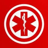 Rotes medizinisches Symbol Stockfotografie