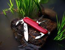 Rotes Messer Stockbild