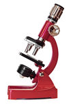 Rotes Mikroskop Lizenzfreie Stockfotos