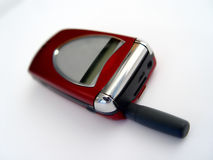 Rotes Mobiltelefon stockfotografie