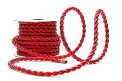 Rotes Netzkabel auf einer Bandspule Lizenzfreie Stockbilder
