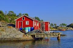 Rotes norwegisches Fischen-Haus Stockfoto