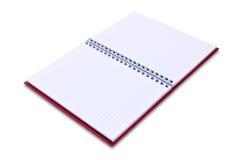 Rotes Notizbuch getrennt Lizenzfreie Stockfotos