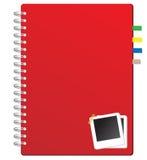 Rotes Notizbuch und Fotofeld Lizenzfreie Stockbilder