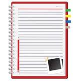 Rotes Notizbuch und Fotofeld Stockfotografie