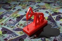 Rotes Pumpjack und verschüttetes Öl auf Vereinigte Arabische Emirate-Dirham Lizenzfreie Stockfotos