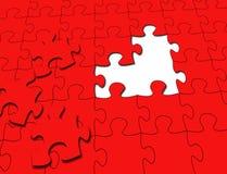 Rotes Puzzlespiel stockfotografie