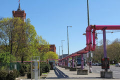 He Rotes Rathaus behind the trees and pink pipes at Alexanderplatz in Berlin, Germany Stock Photo