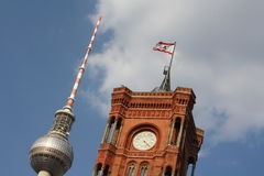 Rotes Rathaus of Berlin and Television Tower. Close-up view of the tower of the city hall of Berlin and the television tower in the background with blue sky and royalty free stock photos