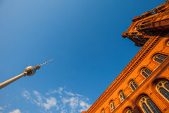 The Rotes Rathaus and Fernsehturm (TV Tower), Berlin. Wide angle view of Rotes Rathaus and Fernsehturm (TV Tower), Berlin Royalty Free Stock Images