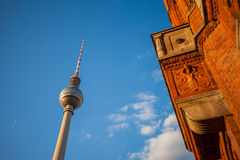 The Rotes Rathaus and Fernsehturm (TV Tower), Berlin. Wide angle view of Rotes Rathaus and Fernsehturm (TV Tower), Berlin Stock Photo