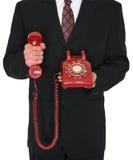Rotes Retro- Telefon-Geschäft lokalisiert Stockfotos