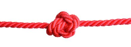 Rotes Seil mit Knoten auf Weiß lizenzfreie stockfotos