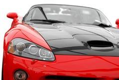 Rotes Sportauto getrennt Lizenzfreie Stockfotografie