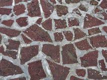 Rotes Steinbeschaffenheitsmosaik Stockbild
