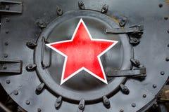 Rotes Sternsymbol der UDSSR mit einem Profil von Gesichtern von Lenin und von Stalin Russland St Petersburg Museums-Eisenbahnen v Stockbild