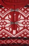 Rotes Strickjacke-Detail Stockbild
