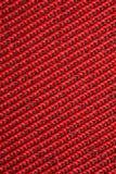 Rotes strukturelles Gewebe, Muster auf Diagonale Stockbild