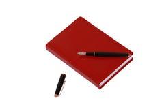 Rotes Tagebuchbuch über Weiß Lizenzfreie Stockfotografie