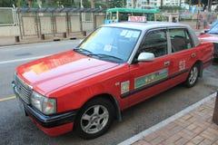 Rotes Taxi in Hong Kong Stockfoto