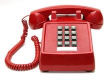 Rotes Telefon mit weißem Hintergrund Stockfotografie