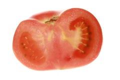 Rotes Tomatengemüse mit dem Schnitt lokalisiert auf Weiß Stockbild