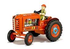 Rotes Traktorspielzeug der Weinlese stockfoto