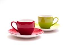 Rotes und grünes Espressocup lizenzfreie stockfotos