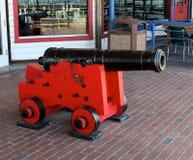 Rotes und schwarzes Kanonenkugel-Gewehr stockfoto