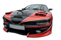 Rotes und schwarzes modernes Sportauto Stockfotos