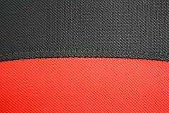 Rotes und schwarzes synthetisches Leder Lizenzfreies Stockbild