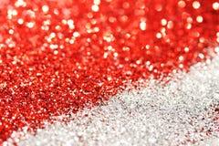 Rotes und silbernes abstraktes bokeh - perfektes Weihnachten und Valentinsgrußhintergrund Lizenzfreie Stockfotos