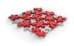 Rotes und silbernes Metallpuzzle Lizenzfreie Stockbilder