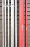 Rotes und silbernes Rohr Stockfotografie